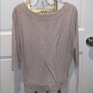 tan color blouse